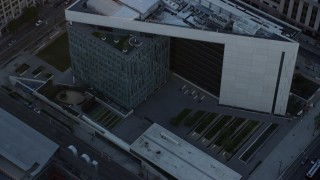 AX0162_074 - 8K stock footage aerial video orbiting the LAPD headquarters at twilight in Downtown Los Angeles, California