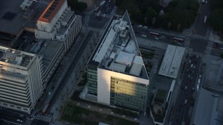 AX0162_075 - 8K stock footage aerial video orbiting LAPD headquarters at twilight in Downtown Los Angeles, California