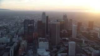 AX0162_086 - 8K stock footage aerial video orbiting the tall towers of downtown at sunset in Downtown Los Angeles, California
