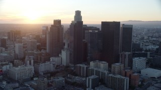 AX0162_088 - 8K stock footage aerial video orbiting tall skyscrapers of downtown at sunset in Downtown Los Angeles, California