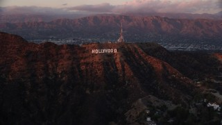 AX0162_101 - 8K stock footage aerial video of the Hollywood Sign at twilight in Los Angeles, California