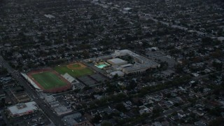 AX0162_111 - 8K stock footage aerial video of John Burroughs High School at twilight in Burbank, California
