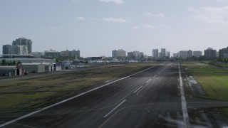 AX101_001 - 5k stock footage aerial video Runway Take Off from Isla Grande Airport, San Juan Puerto Rico