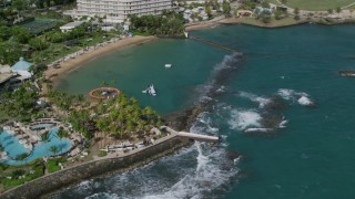 AX101_006 - Aerial stock footage of 5k Aerial Video of Waterfront Caribbean Hotels, San Juan Puerto Rico