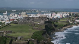 AX101_009 - Aerial stock footage of 5k Aerial Video of a Historic Fort on a Caribbean Island, San Juan Puerto Rico