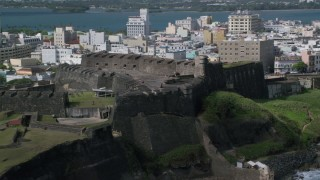 AX101_010 - Aerial stock footage of 5k Aerial Video of Landmark Fort on a Caribbean Island, San Juan Puerto Rico