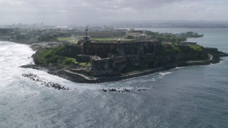 AX101_014 - Aerial stock footage of 5k Aerial Video of a Historic fort along the coast, Old San Juan Puerto Rico