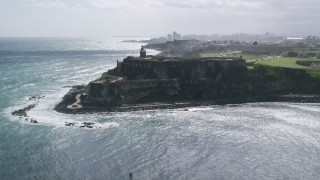 AX101_015 - Aerial stock footage of 5k Aerial Video of a historic fort along the coast with clear blue water, Old San Juan Puerto Rico