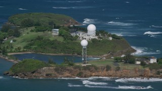AX101_028 - Aerial stock footage of 5k Aerial Video of Punta Salinas Radar Site in the blue waters of the Caribbean, Toa Baja Puerto Rico