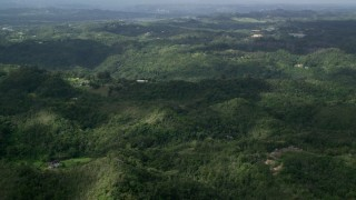 AX101_039 - Aerial stock footage of 5k Aerial Video of Rural homes and tree covered hills, Vega Baja, Puerto Rico