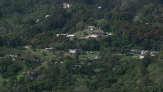 AX101_041 - Aerial stock footage of 5k Aerial Video of Rural homes in the tree covered hills, Vega Baja, Puerto Rico
