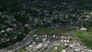 AX101_045 - Aerial stock footage of 5k Aerial Video Fly over residential neighborhoods, Morovis, Puerto Rico