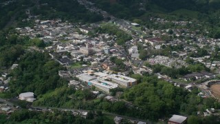 AX101_047 - Aerial stock footage of 5k Aerial Video of a Town surrounded by trees, Ciales, Puerto Rico