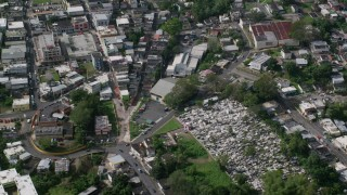 AX101_048 - Aerial stock footage of 5k Aerial Video of a Town with homes and a cemetary, Ciales, Puerto Rico