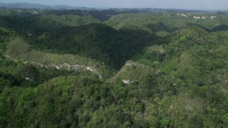 AX101_051 - Aerial stock footage of 5k Aerial Video Flying over jungle mountains, Karst Forest, Puerto Rico
