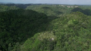 AX101_052 - Aerial stock footage of 5k Aerial Video Flying over mountains and jungle, Karst Forest, Puerto Rico