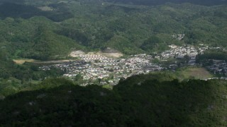 AX101_065 - 5k stock footage aerial video of a Town nestled among lush green trees, Florida, Puerto Rico
