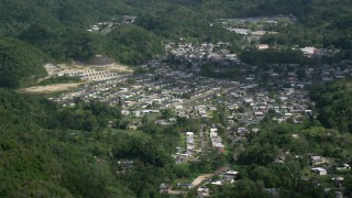 AX101_066 - 5k stock footage aerial video of a Town nestled among lush green trees, Florida, Puerto Rico