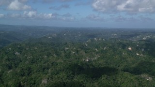 AX101_068 - 5k stock footage aerial video of Limestone cliffs and lush green jungle, Karst Forest, Puerto Rico