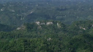 AX101_069 - 5k stock footage aerial video of Limestone cliffs and lush green forests, Karst Forest, Puerto Rico