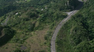 AX101_073 - 5k stock footage aerial video of a Highway winding through lush green forests, Karst Forest, Puerto Rico