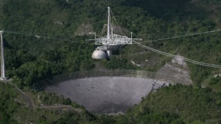 AX101_091 - 5k stock footage aerial video of Arecibo Observatory in the lush green Karst forest, Puerto Rico