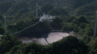 AX101_094 - 5k stock footage aerial video of Arecibo Observatory nestled in Karst forest, Puerto Rico