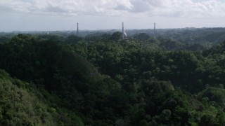 AX101_108 - 5k stock footage aerial video of Arecibo Observatory seen from lush green mountains, Puerto Rico