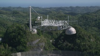 AX101_113 - 5k stock footage aerial video of Arecibo Observatory and lush green trees, Puerto Rico