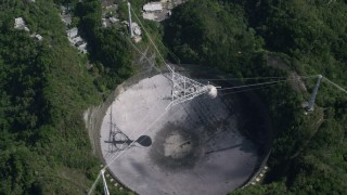 AX101_121 - 5k stock footage aerial video Bird's eye of Arecibo Observatory, Puerto Rico