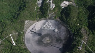 AX101_122 - 5k stock footage aerial video Orbiting above Arecibo Observatory, Puerto Rico