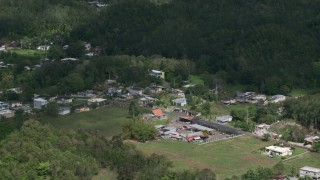 AX101_130 - 5k stock footage aerial video of Rural homes surrounded by trees, Arecibo, Puerto Rico