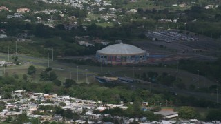 AX101_133 - 5k stock footage aerial video of the Coliseo Manuel Iguina sporting arean, Arecibo Puerto Rico