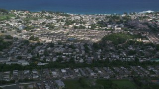 AX101_134 - 5k stock footage aerial video of the Coastal homes and apartment buildings, Arecibo, Puerto Rico