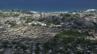 AX101_135 - 5k stock footage aerial video of Homes and apartment buildings near the coast, Arecibo, Puerto Rico