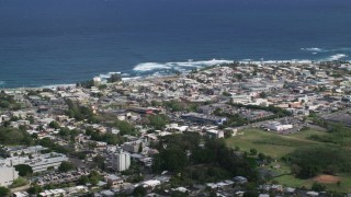 AX101_136 - 5k stock footage aerial video of a Coastal community homes and apartment buildings, Arecibo, Puerto Rico
