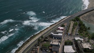 AX101_139 - 5k stock footage aerial video of the Coastal highway, Avenida Victor Rojas, Arecibo, Puerto Rico