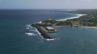 AX101_141 - 5k stock footage aerial video Approaching Arecibo Lighthouse along the harbor and the blue Caribbean waters, Puerto Rico