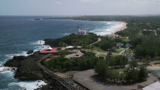 AX101_143 - 5k stock footage aerial video Orbiting Arecibo Lighthouse looking toward the Caribbean, Puerto Rico