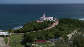 AX101_144 - 5k stock footage aerial video of the Arecibo Lighthouse along the coastal waters of the Caribbean, Puerto Rico