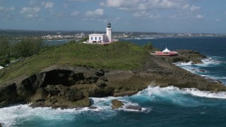 AX101_147 - 5k stock footage aerial video of the Arecibo Lighthouse along the coast, Puerto Rico