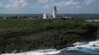 AX101_148 - 5k stock footage aerial video orbiting Arecibo Lighthouse along the coast, Puerto Rico