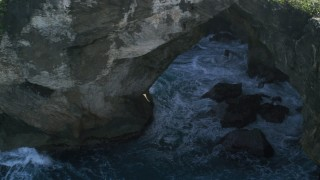 AX101_164 - 5k stock footage aerial video of Rock formations on the coast, Arecibo, Puerto Rico