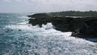AX101_172 - 5k stock footage aerial video Flying by domed rock formations in crystal blue waters along the coast, Arecibo, Puerto Rico