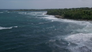 AX101_179 - 5k stock footage aerial video of Crystal blue waters along the beach, Barceloneta, Puerto Rico