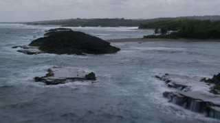 AX101_186 - 5k stock footage aerial video Flying over clear waters and beach along the coast, Manati, Puerto Rico