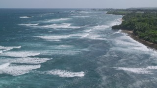 AX101_198 - 5k stock footage aerial video of Waves off of the coast in pristine blue water, Vega Baja, Puerto Rico
