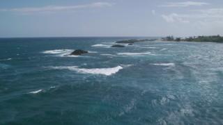 AX101_201 - 5k stock footage aerial video of Rock formations in pristine blue waters, Vega Baja, Puerto Rico