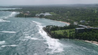 AX101_213 - 5k stock footage aerial video of a Beachfront community along blue water, Dorado, Puerto Rico