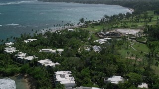AX101_215 - 5k stock footage aerial video of a Private resort and beach, flying over beautiful blue water,  Dorado, Puerto Rico